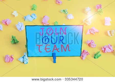 Text sign showing Join Our Team. Conceptual photo Allied Associate Work with us New Employee Hired Enlist Colored crumpled papers empty reminder white floor background clothespin. stock photo