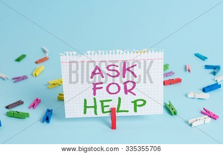 Word writing text Ask For Help. Business concept for Request to support assistance needed Professional advice Colored clothespin rectangle square shaped paper light blue background. stock photo