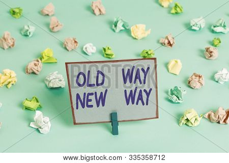 Conceptual hand writing showing Old Way New Way. Business photo text The different way to fulfill the desired purposes Colored crumpled papers empty reminder blue floor clothespin. stock photo