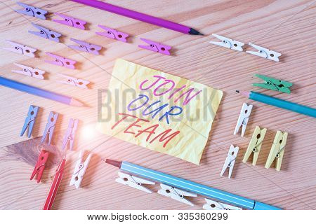 Text sign showing Join Our Team. Conceptual photo Allied Associate Work with us New Employee Hired Enlist Colored clothespin papers empty reminder wooden floor background office. stock photo