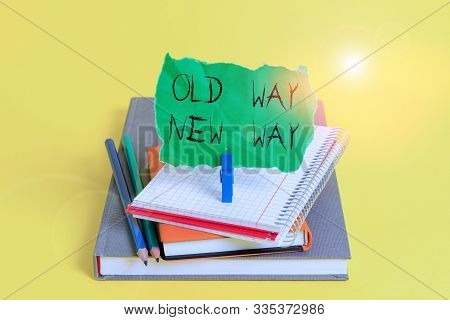 Text sign showing Old Way New Way. Conceptual photo The different way to fulfill the desired purposes Book pencil rectangle shaped reminder notebook clothespin office supplies. stock photo