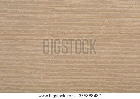 Natural light beige oak veneer background as part of your design. High quality wooden texture. stock photo