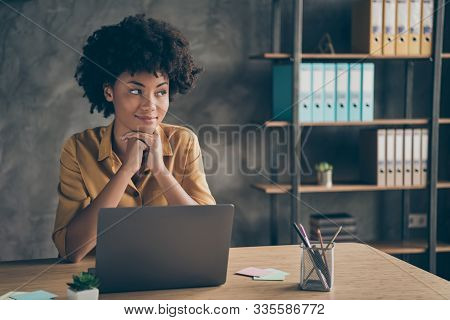 Photo of cheerful cute pretty agent mixed-race having ended working on presentation of her corporation as result of coworking with colleagues stock photo