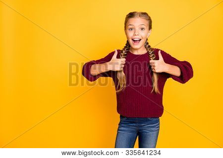 Portrait of her she nice attractive lovely girlish cheerful cheery glad pre-teen girl showing two double thumbup ad advert isolated on bright vivid shine vibrant yellow color background stock photo