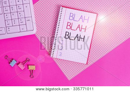 Word writing text Blah Blah Blah. Business concept for Talking too much false information gossips nonsense speaking Writing equipments and computer stuffs placed above colored plain table. stock photo