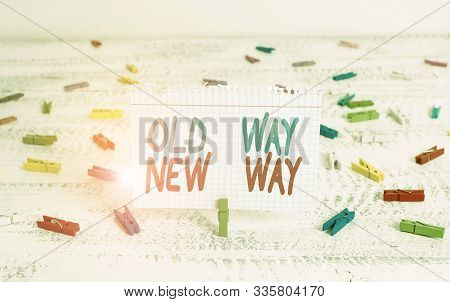 Handwriting text writing Old Way New Way. Concept meaning The different way to fulfill the desired purposes Green clothespin white wood background colored paper reminder office supply. stock photo
