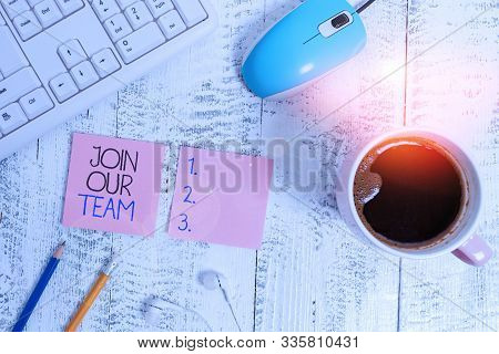 Text sign showing Join Our Team. Conceptual photo Allied Associate Work with us New Employee Hired Enlist technological devices colored reminder paper office supplies keyboard mouse. stock photo