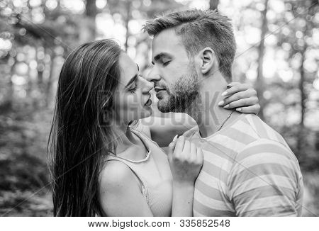 Giving kiss. Seduction and foreplay. Sensual kiss of lovely couple close up. Couple in love kissing with passion outdoors. Man and woman attractive lovers romantic kiss. Passionate kiss concept stock photo