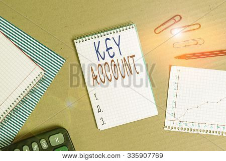 Handwriting text writing Key Account. Concept meaning individual approach of sales showing to their customers Striped paperboard notebook cardboard office study supplies chart paper. stock photo