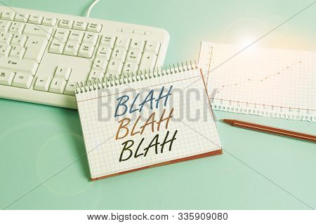 Text sign showing Blah Blah Blah. Conceptual photo Talking too much false information gossips nonsense speaking Paper blue desk computer keyboard office study notebook chart numbers memo. stock photo