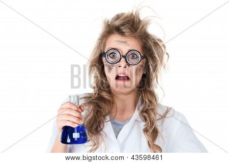 Crazy chemist woman with disheveled hair and vial in hands stock photo