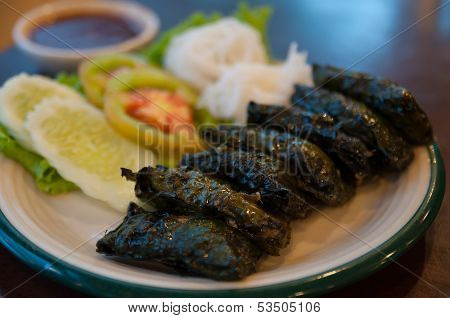 Vietnamese food consists pork that were encapsulated by a plu leaves stock photo