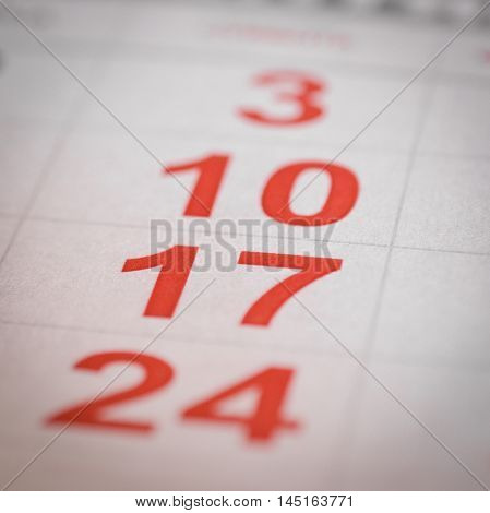 close up red white calendar seventeen number stock photo