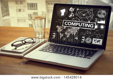 COMPUTING (data Computer Digital Memory) Computing Computer Laptop with screen on table Silhouette and filter sun stock photo