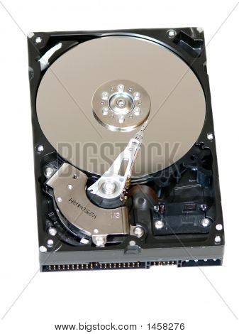 An open hard drive with disc and needle in close-up. 