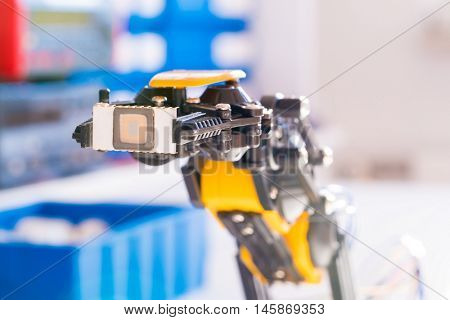 IC electronics chip in robot arm stock photo