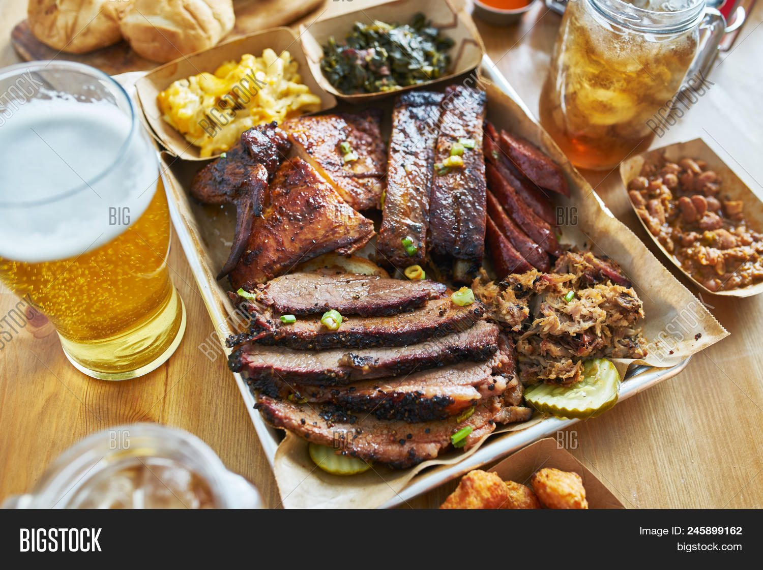 Texas Style Bbq Tray With Smoked Brisket St Louis Ribs Pulled Pork Chicken Hot Links And Sides Image Stock Photo 245899162