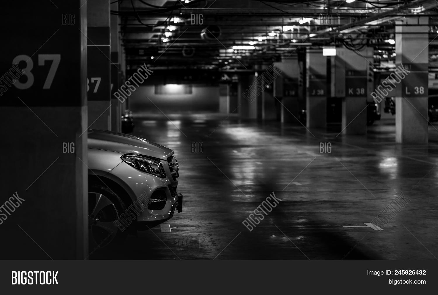 37,38,abandoned,architecture,automobile,background,basement,block,building,business,car,cement,city,concept,concrete,dark,drive,empty,floor,garage,indoor,industry,inside,interior,large,light,line,lot,mall,night,nobody,old,open,park,parking,pole,public,row,shopping,sign,silver,structure,technology,traffic,transport,transportation,travel,underground,urban,vehicle