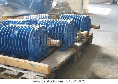 Electro motors blue in stock. Warehouse for new engines stock photo