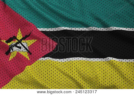 Mozambique flag printed on a polyester nylon sportswear mesh fabric with some folds stock photo