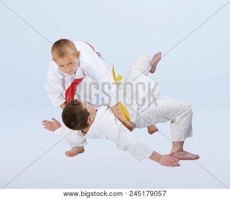Judo throws are training boys in judogi stock photo