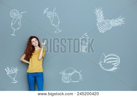 Reliable nutritionist. Professional experienced nutritionist looking confident and pointing her finger up while giving a lecture about healthy food stock photo