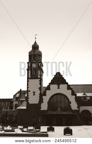 The historic building of the main station in Bad Homburg in the backlight. stock photo