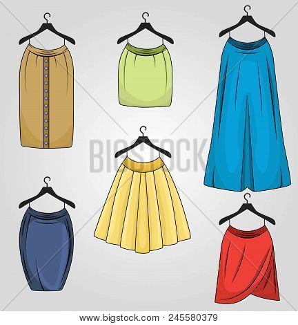 Set of skirts in different colors and different styles drapped, pencil, tulip, long fix box pleat, buttoned straight on hangers. Women clothing. stock photo