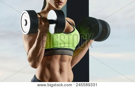 Cropped Photo Of Strong Fit Model Training In Gym , Doing Fitness Lifting Exercises With Heavy Dumbb