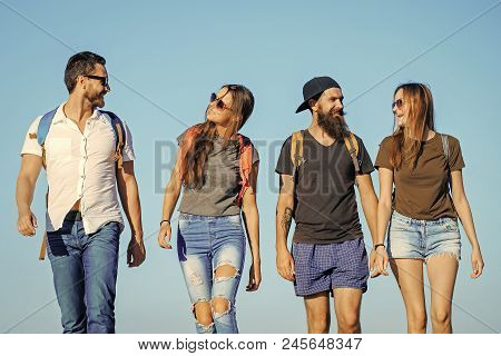 lifestyle Wanderlust vacation travel hiking Happy friends on blue sky, wanderlust. Men and women travel on summer vacation. Friendship, friends, young people, youth, relations. Fashion, style, stock photo