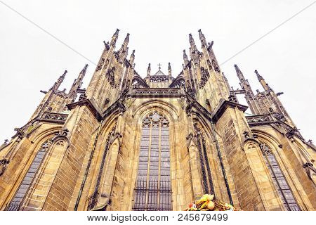 Romanesque style St. George's Basilica from bottom in a cloudy day. Easter ornamented wood stalls roof. Negative copy space, place for text. Prague, Czech Republic stock photo
