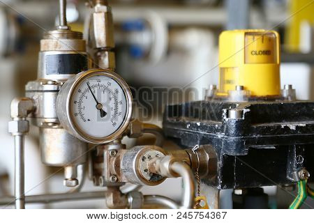 Pressure gauge using measure the pressure in production process. Worker or Operator monitoring oil and gas process by the gauge for routine record and analysis oil and gas production process. stock photo