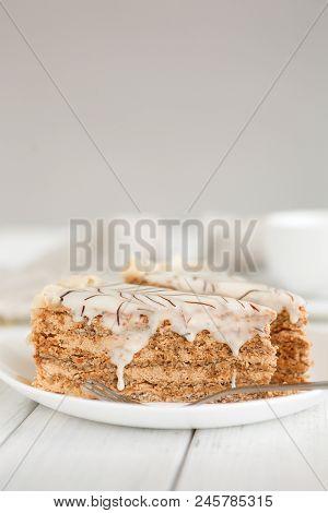 Esterhazy cake sliced on white plate. Delicatessen sweet dessert with almond meringue dough and buttercream, traditional hungarian, austrian cuisine, copy space stock photo