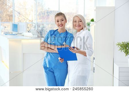 Female receptionist with trainee in hospital stock photo