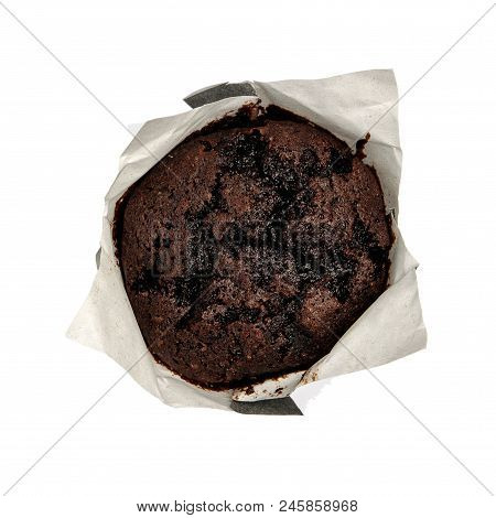 Closeup of a Magdalena Typical Spanish Chocolate Muffin. Sweet Food or Dessert. One Fresh Baked Muffin Isolated on White Background in American Style. Irresistible Tasty Cake. stock photo