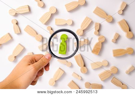 Wooden figures of people are lying on a white background. Social network. Business. The concept of human resources management. Headhunters. Search for people to work. The search for the second half. stock photo