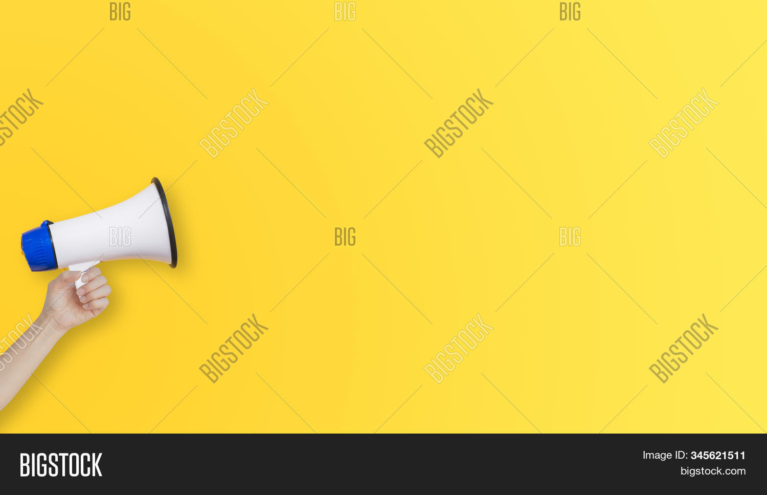 Business Communication and Marketing Concept : Female hand holding megaphone for announcement and advertisement.