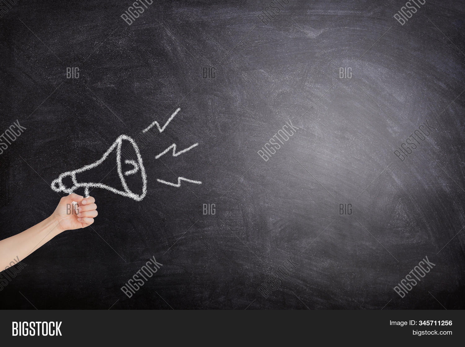 Business Communication and Marketing Concept : Female hand holding megaphone white chalk icon on blackboard for announcement and advertisement.