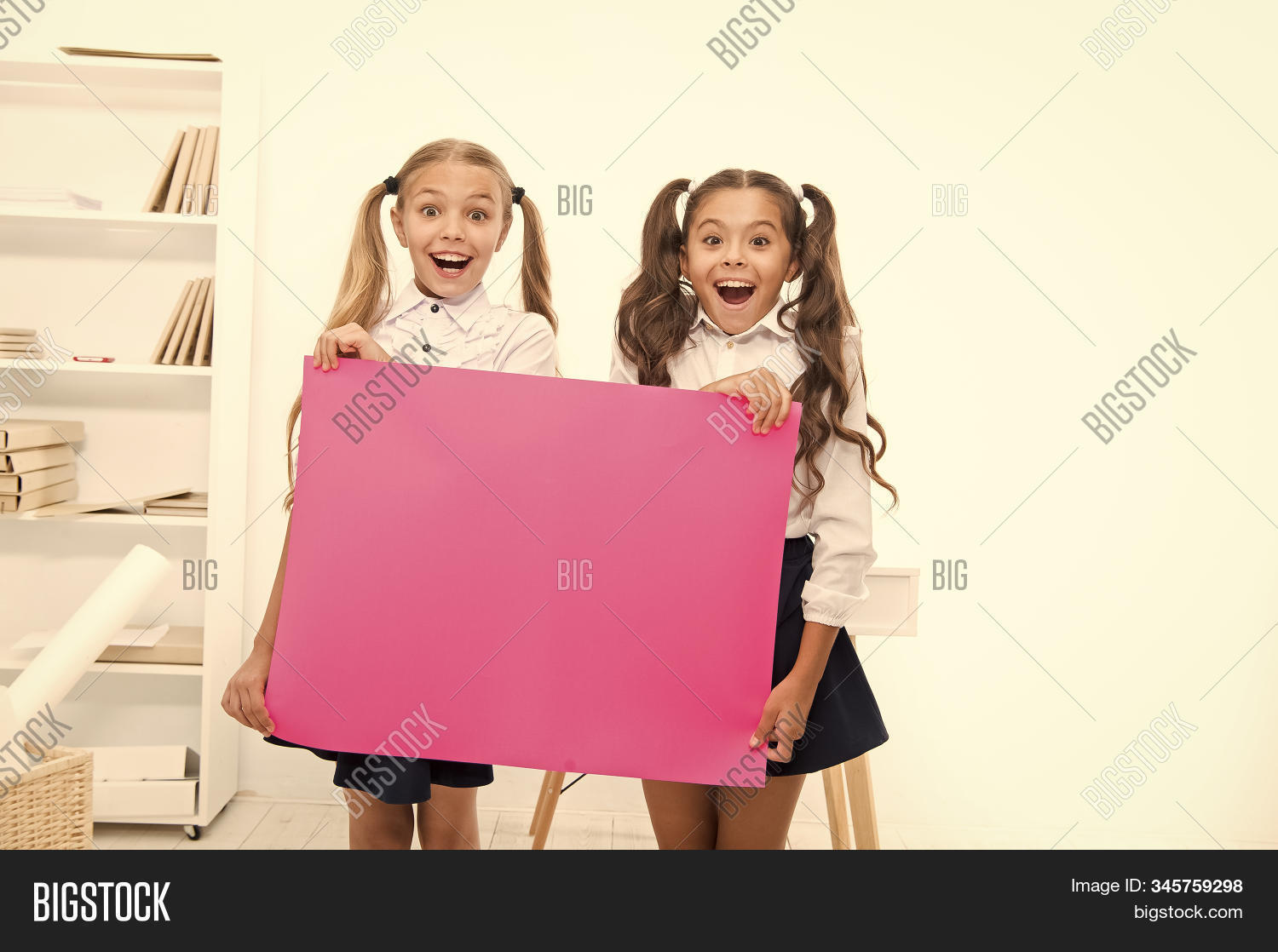 Schoolgirls holding banner announcement. Children greetings copy space. Happy holidays. Congratulations to you. September 1. Congratulations concept. Amazing news. Girls hold congratulations banner.