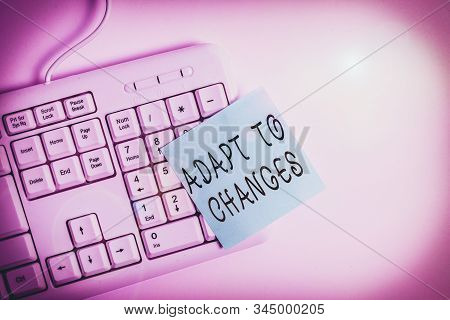 Writing note showing Adapt To Changes. Business photo showcasing Embrace new opportunities Growth Adaptation progress White pc keyboard with empty note paper above white background. stock photo