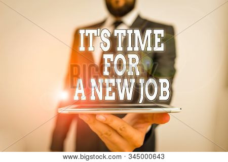 Word writing text It S Time For A New Job. Business concept for Career changes seeking other work Recruitment Male human wear formal work suit hold smart hi tech smartphone use one hand. stock photo