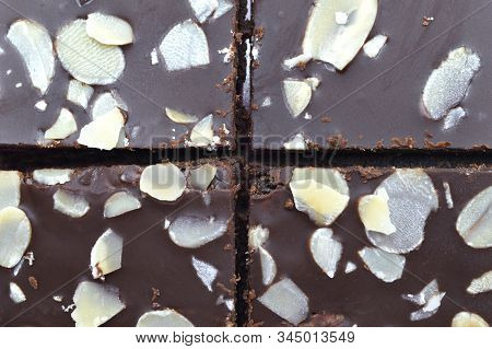 Background of fresh bake chocolate brownies with sliced almond nuts toppings isolated on white background. stock photo