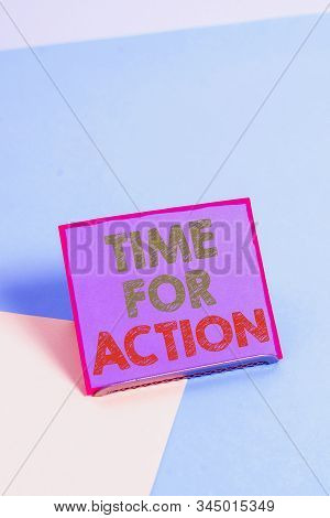 Word writing text Time For Action. Business concept for getting ready to start doing encouragement Go fast Paper placed tilted above buffer wire on soft pastel multi colours backdrop. stock photo