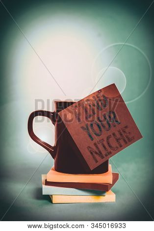 Conceptual hand writing showing Find Your Niche. Business photo showcasing Market study seeking specific potential clients Marketing Coffee cup colored sticky note stacked pads plain background. stock photo