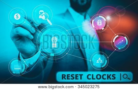 Word writing text Reset Clocks. Business concept for To revisit return to or recreate a time or era from the past Male human wear formal work suit presenting presentation using smart device. stock photo