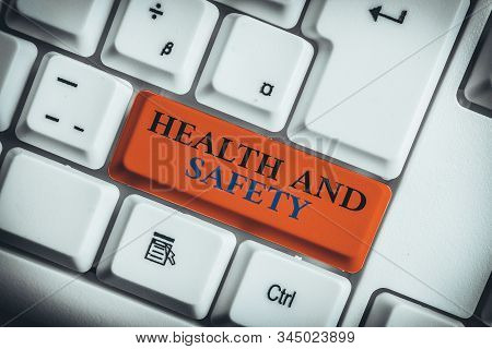 Word writing text Health And Safety. Business concept for procedures intended to prevent accident in workplace White pc keyboard with empty note paper above white background key copy space. stock photo