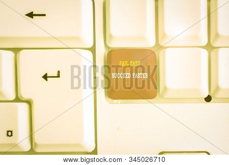 Text sign showing Fail Fast Succeed Faster. Conceptual photo dont give up keep working on it to achieve White pc keyboard with empty note paper above white background key copy space. stock photo