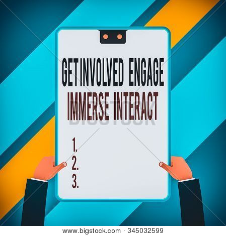 Word writing text Get Involved Engage Immerse Interact. Business concept for Join Connect Participate in the project Two executive male hands holding electronic device geometrical background. stock photo