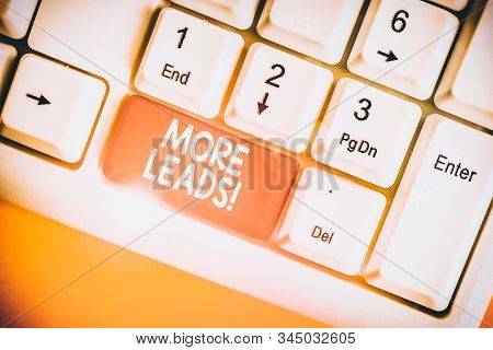 Text sign showing More Leads. Conceptual photo initiation of consumer interest or enquiry into product White pc keyboard with empty note paper above white background key copy space. stock photo