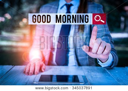 Word writing text Good Morning. Business concept for expressing good wishes on meeting or parting during the morning Female business person sitting by table holding mobile phone. stock photo